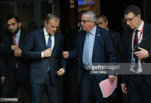 European Council President Donald Tusk and European Commission President Jean-Claude Juncker arrive to speak to the media at the conclusion of a...
