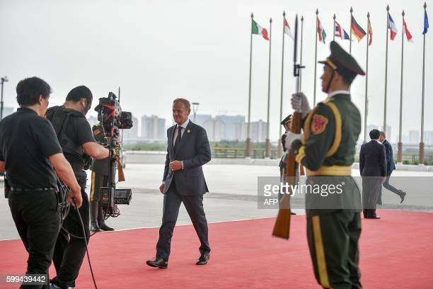 European Council President Donald Tusk arrives at the Hangzhou Exhibition Center to participate in the G20 Summit in Hangzhou on September 4, 2016....