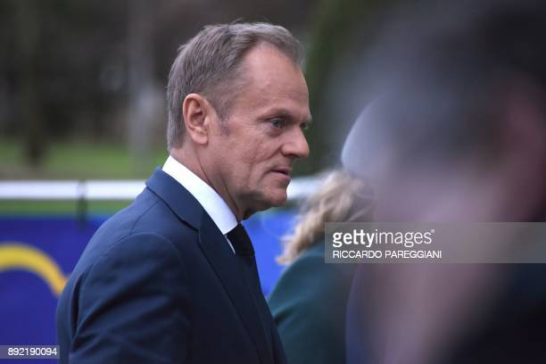 European Council President Donald Tusk arrives to attend a meeting of the European People's Party in Brussels on December 14 ahead of a summit of...