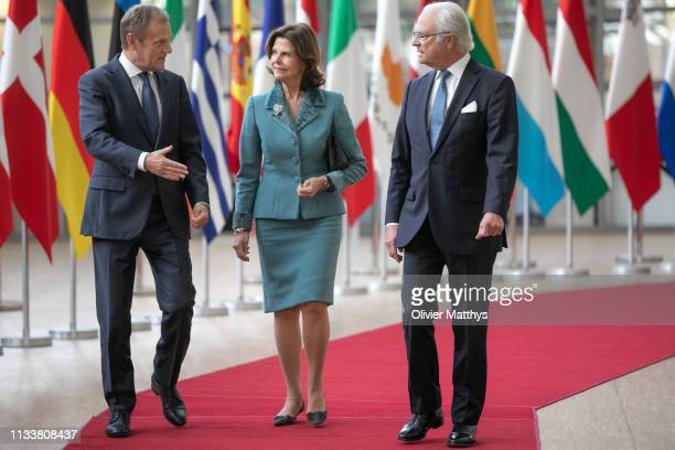 European Council President Donald Tusk arrives with King Carl Gustav of Sweden and Queen Silvia during an official visit to the European Institutions...
