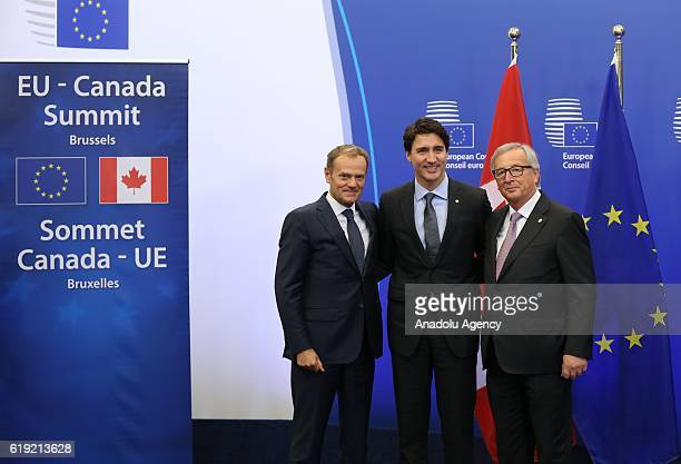 European Council President Donald Tusk Canadian Prime Minister Justin Trudeau and European Commission President JeanClaude Juncker pose as they...