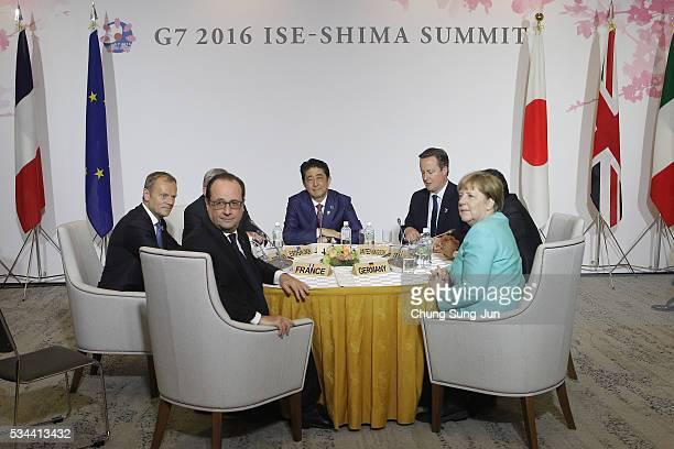 European Council President Donald Tusk, French President Francois Hollande, Japanese Prime Minister Shizo Abe, British Prime Minister David Cameron,...