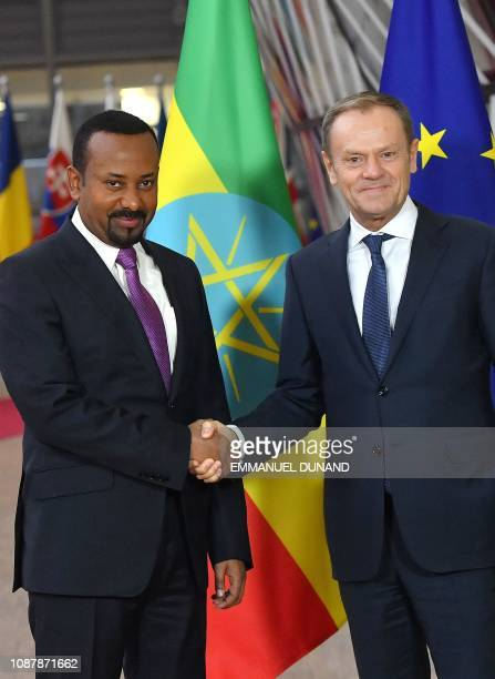 European Council President Donald Tusk greets Ethiopia's Prime Minister Abiy Ahmed upon the latter's arrival at the European Council in Brussels on...