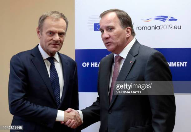 European Council President Donald Tusk greets Swedish Prime Minister Stefan Lofven during a meeting prior to an EU summit in Sibiu central Romania on...