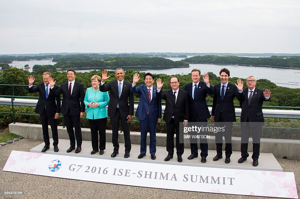 TOPSHOT - (From L) European Council President Donald Tusk, Italian Prime Minister Matteo Renzi, German Chancellor Angela Merkel, US President Barack Obama, Japanese Prime Minister Shinzo Abe, French President Francois Hollande, British Prime Minister David Cameron, Canadian Prime Minister Justin Trudeau and European Commission President Jean-Claude Juncker pose for the family photo during the first day of the Group of Seven (G7) summit meetings in Ise city on May 26, 2016. World leaders kick off two days of G7 talks in Japan on May 26 with the creaky global economy, terrorism, refugees, China's controversial maritime claims, and a possible Brexit headlining their packed agenda. / AFP /