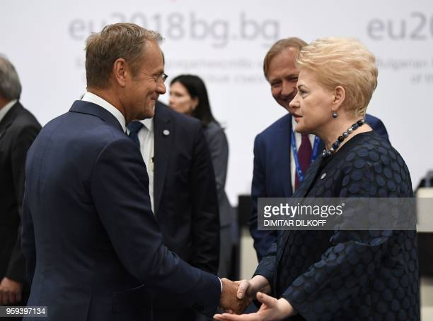 European Council President Donald Tusk speaks with Lithuania's President Dalia Grybauskaite as they attend the EUWestern Balkans Summit in Sofia on...