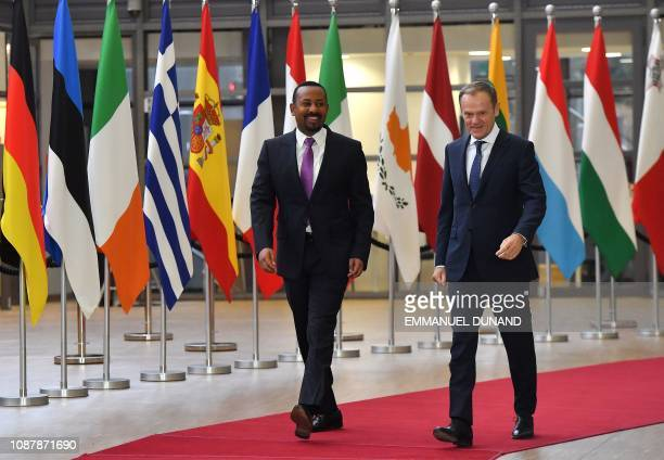 European Council President Donald Tusk walks alongside Ethiopia's Prime Minister Abiy Ahmed upon the latter's arrival at the European Council in...