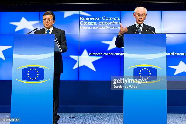 European Council President Herman Van Rompuy and Jose Manuel Barrosso talk during a media conference after an EU summit in Brussels on Friday, Oct....