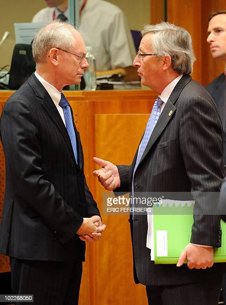 European Council president Herman Van Rompuy speaks with Luxembourg's Prime Minister JeanClaude Juncker at the start of an European Council summit...