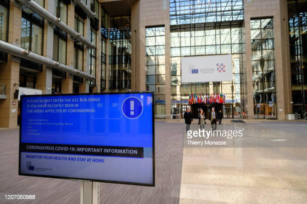 European Council shows screens with COVID19 disease instructions at the Justus Lipsius the European Council headquarters on March 13 2020 in Brussels...