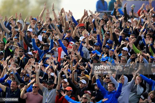 European crowds celebrate Europe's 175 105 victory during the final day singles matches of the 2018 Ryder Cup at Le Golf National on September 30...