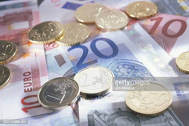 European currency:  assorted Euro coins and banknotes, close-up
