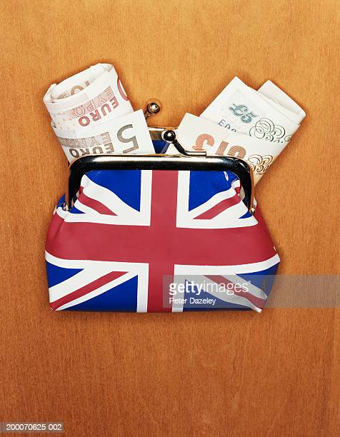 European currency: British and Euro banknotes in Union Jack purse