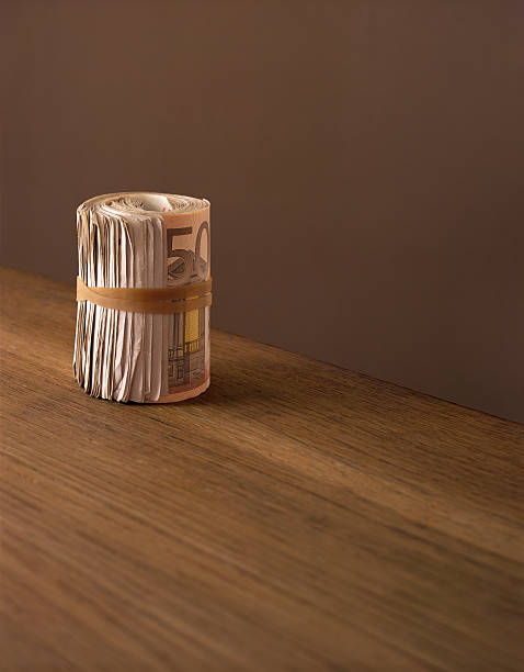 European currency; roll of Euro banknotes