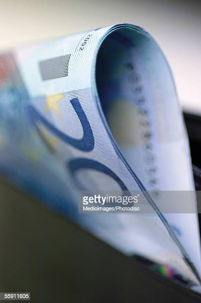 european currency: twenty euro bank note in wallet - twenty euro banknote stock photos and pictures