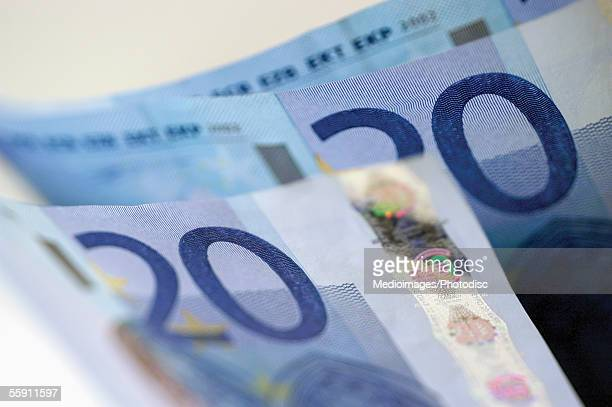 european currency: twenty euro bank notes - twenty euro banknote stock photos and pictures