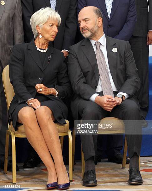 European Economic and Financial Affairs Commissioner Pierre Moscovici listens to International Monetary Fund Managing Director Christine Lagarde as...