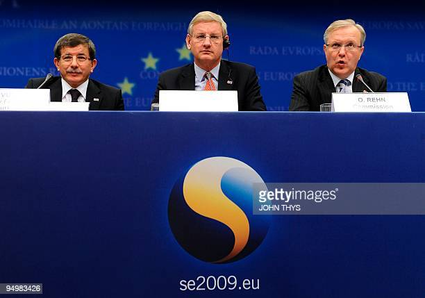 European Enlargement commissioner Olli Rhen speaks during a joint press with Swedish Foreign Minister Carl Bildt and Turkey's Foreign Minister Ahmet...