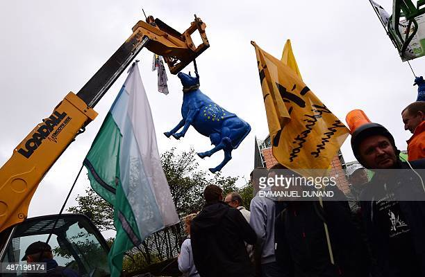 European farmers stage a protest blocking access to the European institutions in Brussels September 7 2015 Angry farmers staged a protest against...