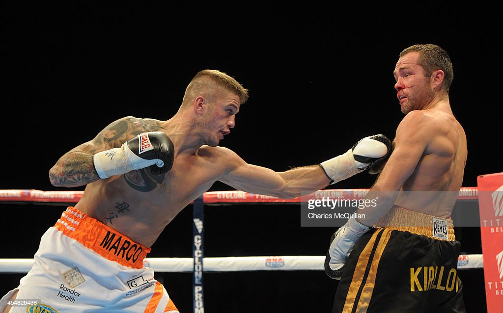 WBO European Featherweight champion Marc McCullough of Northern Ireland lands a punch against Dmitry Kirillov of Russia during their bout on the Frampton Martinez undercard, at the purpose-built 16,000 capacity Titanic slipway outdoor arena on September 6, 2014 in Belfast, Northern Ireland. (Photo by Charles McQuillan/Getty Images).