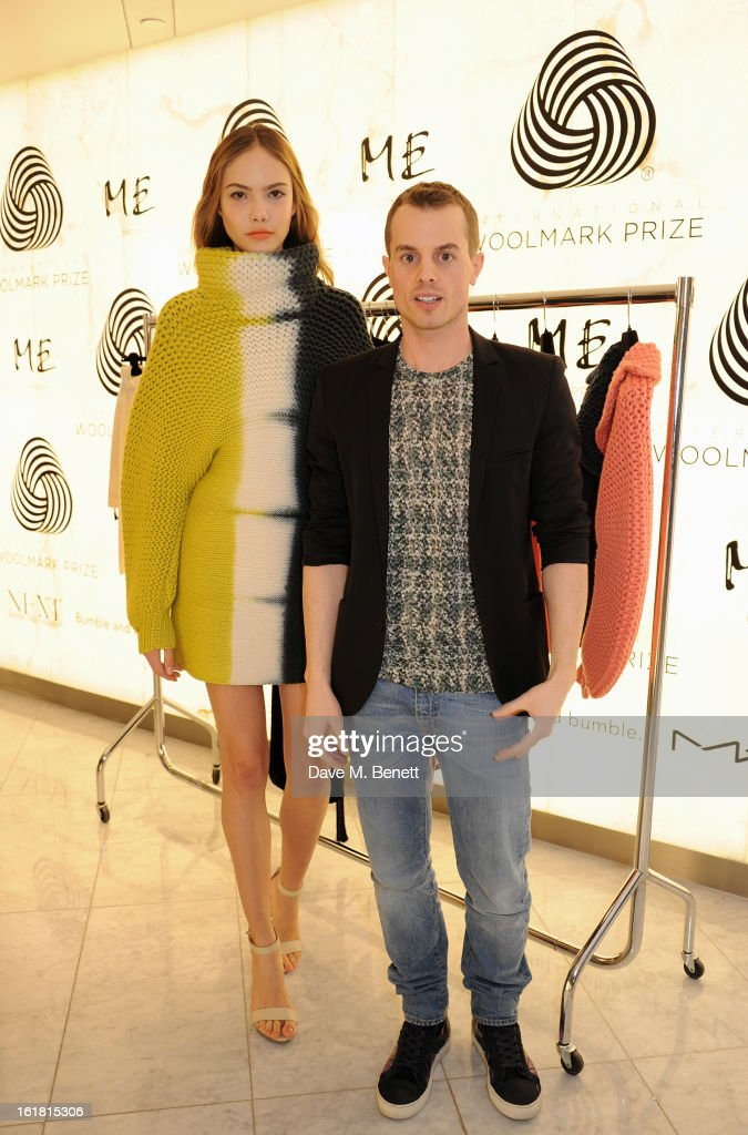 European finalist Christian Wijnats (R) poses with a model wearing his design at the 2013 International Woolmark Prize Final at ME London on February 16, 2013 in London, England.