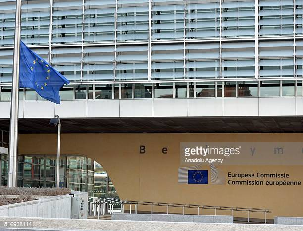 European flag flies at half mast in front of the EU Berlaymont building in the centre of Brussels following multiple blasts in Brussels Belgium on...