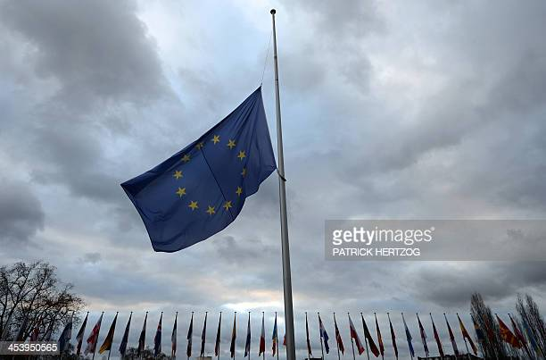 A European flag flies at halfmast as a tribute to late South African antiapartheid icon Nelson Mandela in front of the Council of Europe building in...