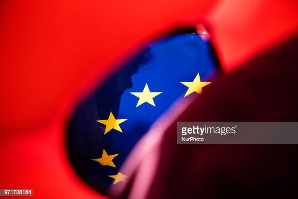 A European flag is seen through a life jacket during a rally in Rome Italy on June 11 2018 against Italian government decision to block ports to a...