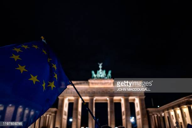 European flag is waved during a flashmob to mark Brexit in front of Berlin's Brandenburg Gate on January 31, 2020. - Britain on January 31 ends...