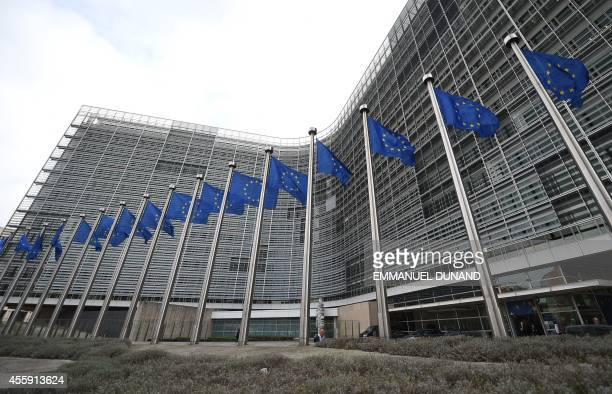 European flags flutter in front of the European Commissions Berlaymont building in Brussels on September 22 2014 Belgian authorities confirmed they...
