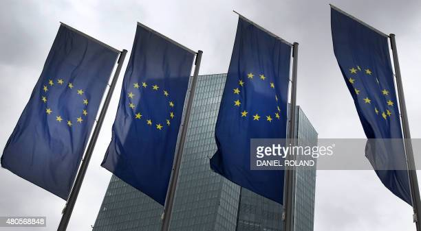 European flags flutter in front of the headquarters of the European Central Bank in Frankfurt am Main western Germany on July 13 after eurozone...