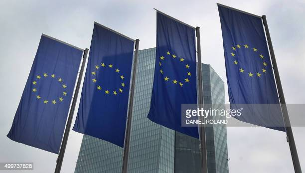 European flags flutter in front of the headquarters of the European Central Bank in Frankfurt am Main western Germany on December 3 2015 The European...