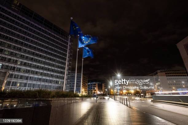European flags fly in front of the Berlaymont. The building of the European Parliament on October 20, 2020 in Brussels, Belgium. Bars and restaurants...