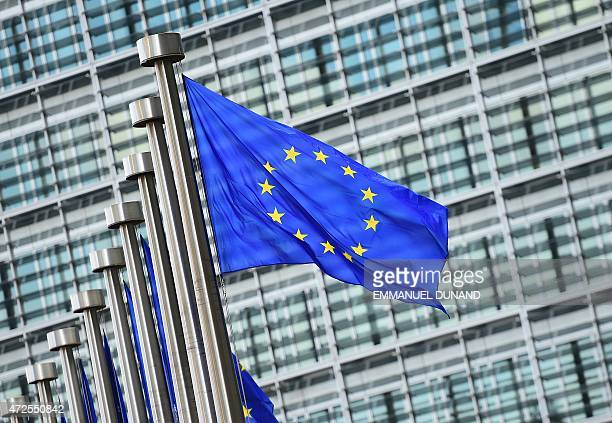 European flags fly outside the European Commission building in Brussels on May 8 2015 AFP PHOTO / EMMANUEL DUNAND