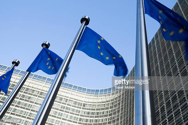 european flags in front of the berlaymont building in brussels - brussels capital region stock photos and pictures