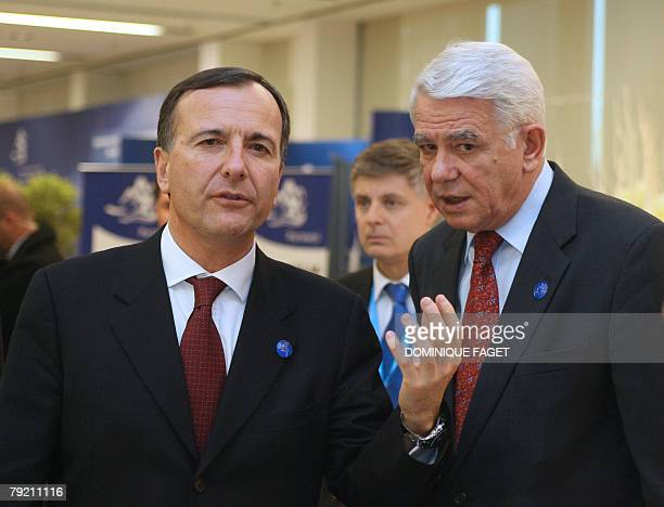 European Justice Freedom and Security Commissioner Franco Frattini talks with Romanian Justice Minister Teodor Viorel Melescanu before an Informal...