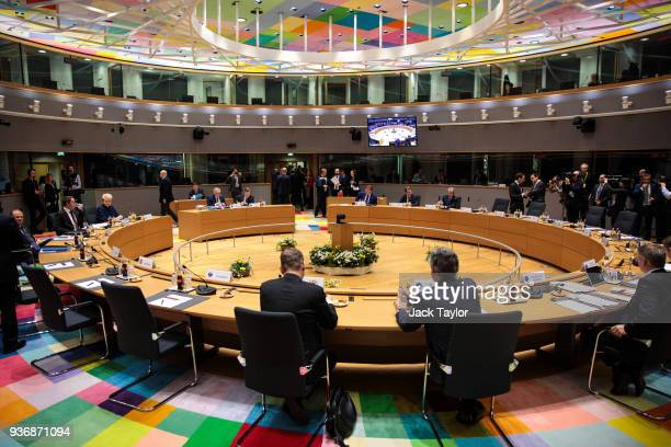 European leaders begin to take their seats ahead of roundtable discussions in the Europa Building on the final day of the European Council leaders'...