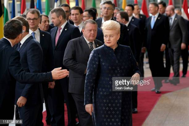 European leaders including Lithuanian President Dalia Grybauskaite arrive for the family photo during a celebration to mark the 25th anniversary of...