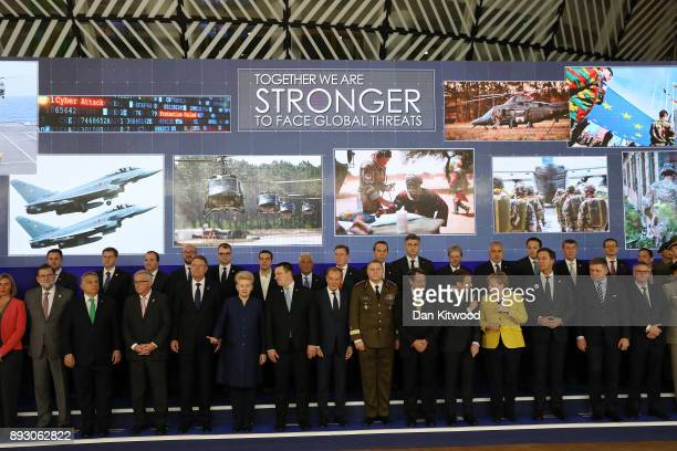 European leaders pose during the launch of the Permanent Structured Cooperation a pact between 25 EU governments to fund develop and deploy armed...