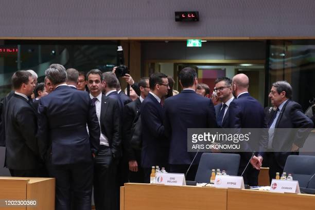 European leaders speak prior to a plenary session during the second day of a special European Council summit in Brussels on February 21 held to...