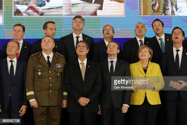 European leaders watch a drone demonstration during the launch of the Permanent Structured Cooperation a pact between 25 EU governments to fund...