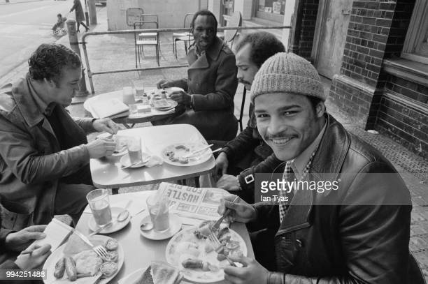 European light-heavyweight champion John Conteh enjoys a steak breakfast with his manager George Francis , Frank Conteh and boxer Bunny Johnson , at...