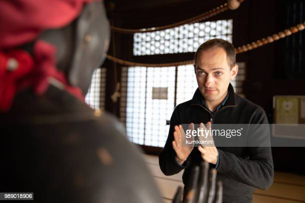 European man praying at temple