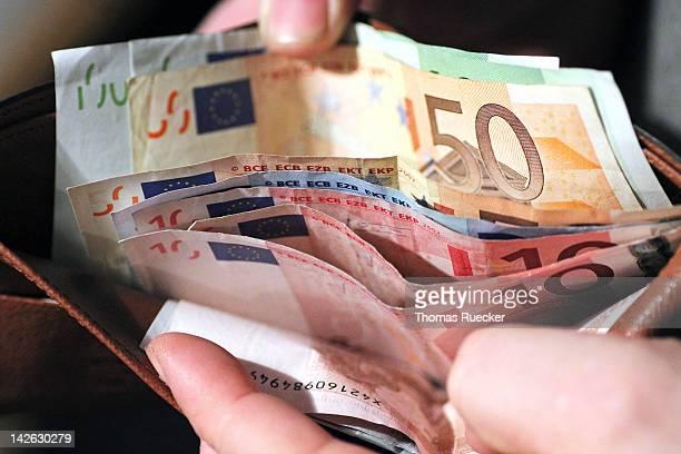 european money in a wallet - euro stock-fotos und bilder