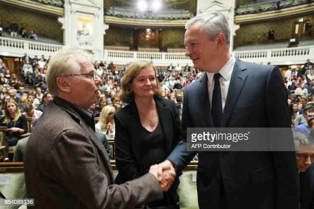 European MP Daniel CohnBendit shakes hand with French Economy Minister Bruno Le Maire as French Minister of European Affairs Nathalie Loiseau looks...