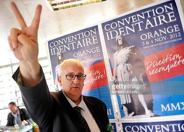 European MP of the Italian party Lega Nord Mario Borghezio gestures while taking part in a French far-right organization Bloc Identitaire two-day...