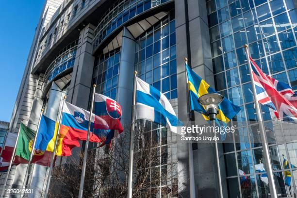 european national flags in front of european parliament building - スロベニア国旗 ストックフォトと画像