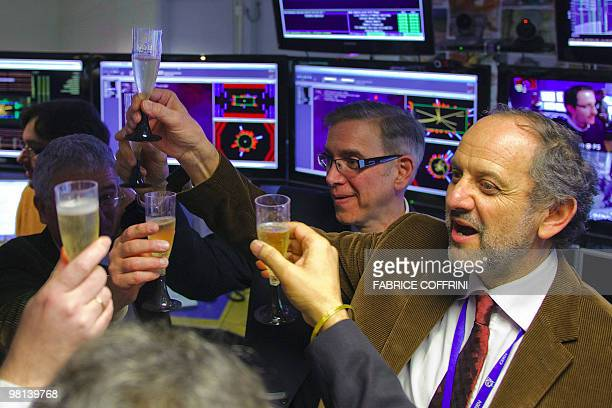 European Organization for Nuclear Research scientists celebrate with champagne reacts after the first ultra highenergy collisions at the CMS...