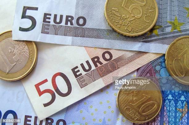 european paper and coin currency in portugal - banconote euro foto e immagini stock
