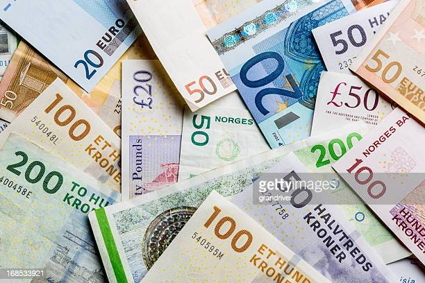 european paper currency, kroners, pounds and euros in a pile - pound sterling note stock photos and pictures